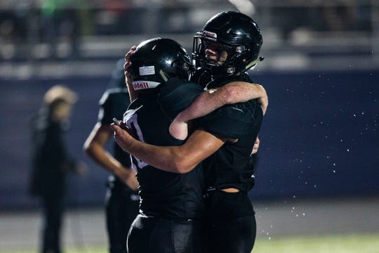 Liberty's Jack Ankenbauer, left, gets embraced by Brian Lively after scoring a touchdown during a Class 3A varsity football game, Friday, Sept., 27, 2019, at Liberty High School in North Liberty, Iowa.