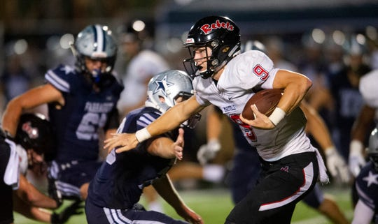 Maryville's Cade Chambers (9) pushes past Farragut defense during the Farragut and Maryville high school football game on Friday, September 27, 2019 at Farragut High School.