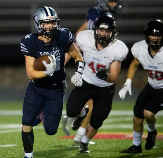 Farragut's Sam Kniss (34) runs past Maryville defense during the Farragut and Maryville high school football game on Friday, September 27, 2019 at Farragut High School.