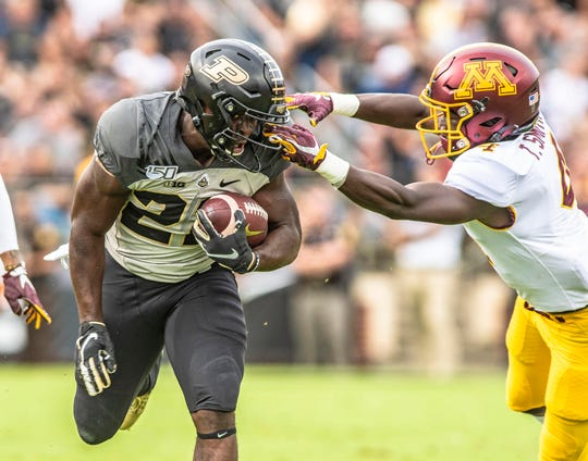 Sep 28, 2019; West Lafayette, IN, USA; Purdue Boilermakers running back King Doerue (22) has his face mask pulled by  Minnesota Gophers defensive back Terell Smith (4)  during the first half  at Ross-Ade Stadium. Mandatory Credit: Thomas J. Russo-USA TODAY Sports