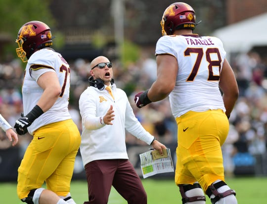 Sep 28, 2019; West Lafayette, IN, USA;  Minnesota Gophers head coach P.J. Fleck celebrates a touchdown with lineman Daniel Faalele (78) in the first half against the Purdue Boilermakers at Ross-Ade Stadium. Mandatory Credit: Thomas J. Russo-USA TODAY Sports