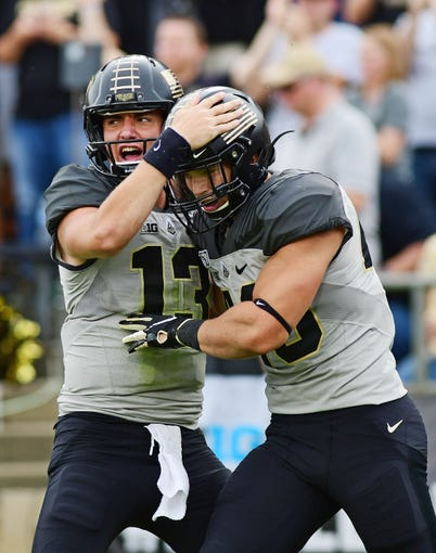 Sep 28, 2019; West Lafayette, IN, USA; Purdue Boilermakers quarterback Jack Plummer (13) celebrates after a first half touchdown against the  Minnesota Gophers at Ross-Ade Stadium. Mandatory Credit: Thomas J. Russo-USA TODAY Sports