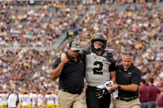 Purdue quarterback Elijah Sindelar (2) is helped off the field after an injury during the first quarter of a NCAA football game, Saturday, Sept. 28, 2019 at Ross-Ade Stadium in West Lafayette.
