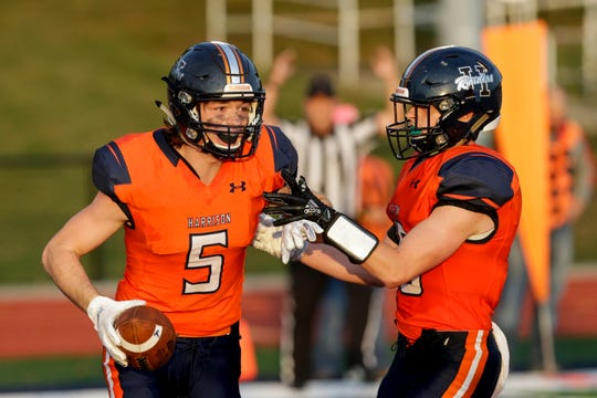 Harrison wide receiver Jake Smith (5) and Harrison running back Stevie Coffing (16) celebrate during the first quarter of an IHSAA football game, Friday, Sept. 27, 2019 at Harrison High School in West Lafayette. Harrison won, 28-0.
