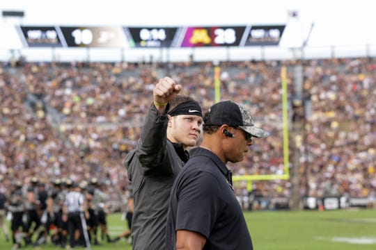 Purdue quarterback Elijah Sindelar (2) raises his fist as he is escorted off the field with a trainer during the second quarter of a NCAA football game, Saturday, Sept. 28, 2019 at Ross-Ade Stadium in West Lafayette.