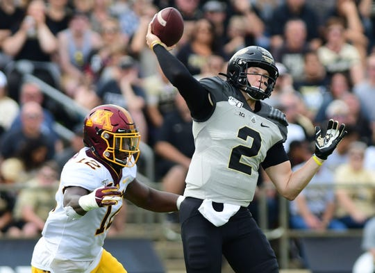 Sep 28, 2019; West Lafayette, IN, USA; Purdue Boilermakers starting quarterback Elijah Sindelar  (2) drops back to pass while being pressured by Minnesota Gopher lineman Tai' Devers (12) during the first half  at Ross-Ade Stadium. Mandatory Credit: Thomas J. Russo-USA TODAY Sports