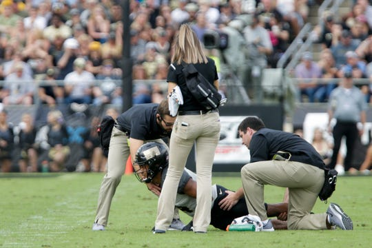 Purdue wide receiver Rondale Moore (4) is looked at by trainers after an injury during the first quarter of a NCAA football game, Saturday, Sept. 28, 2019 at Ross-Ade Stadium in West Lafayette.