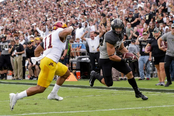 Purdue running back Zander Horvath (40) runs the ball past Minnesota defensive back Antoine Winfield Jr. (11) for a touchdown during the second quarter of a NCAA football game, Saturday, Sept. 28, 2019 at Ross-Ade Stadium in West Lafayette.