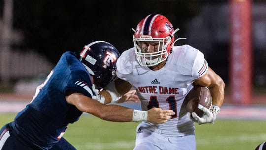Notre Dame running back C.J. Thibodeaux runs the ball as the Teurlings Catholic Rebels take on the Notre Dame Pios Friday, Sept. 27, 2019.