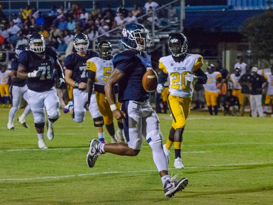 Lafayette Christian's Errol Rogers Jr. scores a touchdown against St. Helena. Friday, Sep. 27, 2019