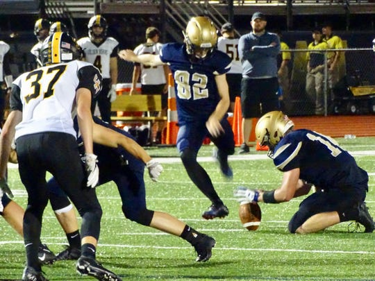 Lancaster's Phillip Slater kicks one of his two field goals during the Gales' 31-21 loss to Upper Arlington.