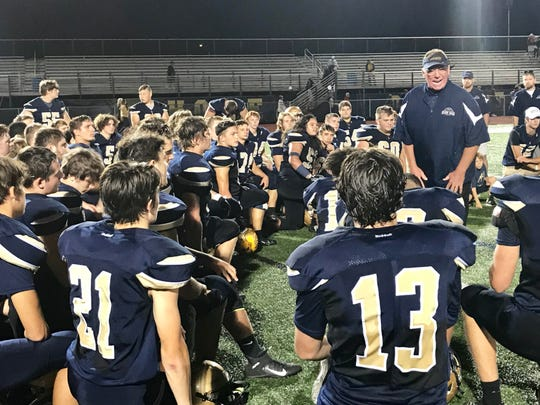 Lancaster head coach Rob Carpenter talks to his team after the Golden Gales' 31-21 loss to Upper Arlington Friday night at Fulton Field.