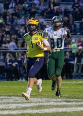 Hartland's Colby Spisz cruises into the end zone for his second touchdown against Howell on Friday, Sept. 27, 2019.