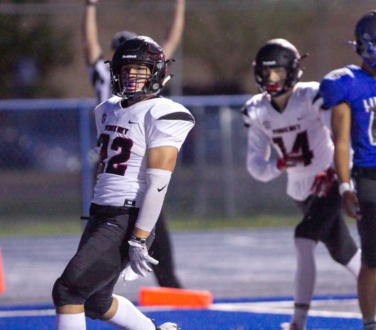 Pinckney's Sal Patierno celebrates the first of his two touchdowns in a 40-14 victory at Ypsilanti Lincoln on Friday, Sept. 27, 2019.