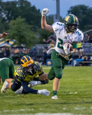 Howell's Bryan Greene scampers into the end zone against Hartland on Friday, Sept. 27, 2019.