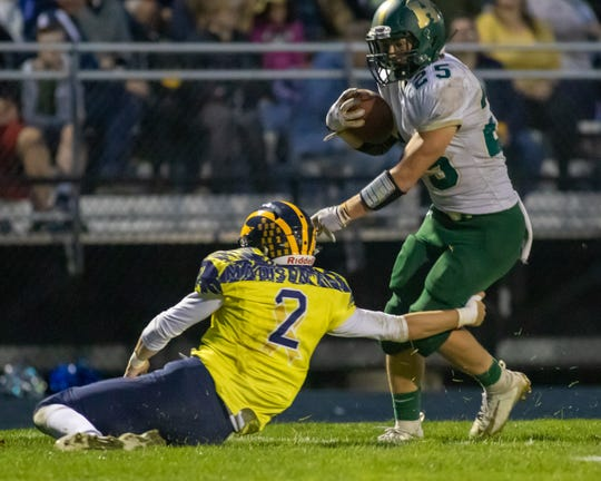 Hartland's Logan Tobel makes a touchdown-saving tackle on Howell's Jonah Schrock on Friday, Sept. 27, 2019.