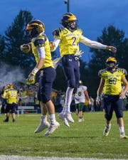 Colby Spisz (left) celebrates his second touchdown against Howell with Carson Neuer on Friday, Sept. 27, 2019.