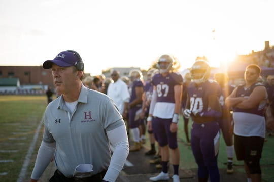 Male High School football coach Chris Wolfe paces the sideline during the game played against Butler High School in Louisville, Ky., Friday, Sep. 27, 2019.