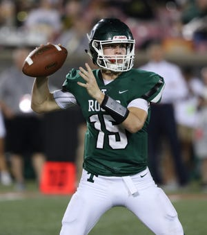 Trinity QB Nathan Mcelroy (15) looked to pass against St. X during their game at Cardinal Stadium.Sep. 27, 2019