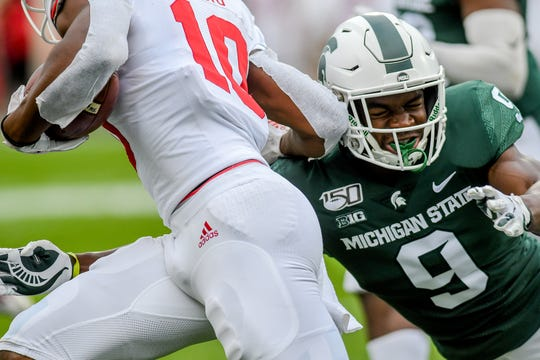 Michigan State's Dominique Long, right, tackles Indiana's David Ellis on a kick return during the second quarter on Saturday, Sept. 28, 2019, in East Lansing.
