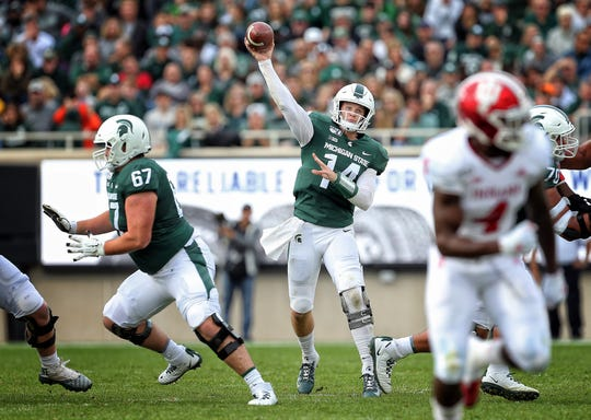 True freshman left guard J.D. Duplain (67) blocks for QB Brian Lewerke during the first half of Michigan State's 40-31 win over Indiana on Saturday.