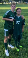Seniors James Wagner and Chris Kukowski pose for a photo before a soccer match. The two have formed a special bond as teammates and friends and no one was more happy to see Kukowski score a goal than Wagner.