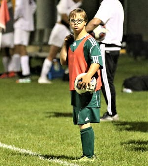 Madison senior Chris Kukowski, who has a genetic condition known as downs syndrome, scored his first varsity goal in a Sept. 14 match against Oregon Clay.