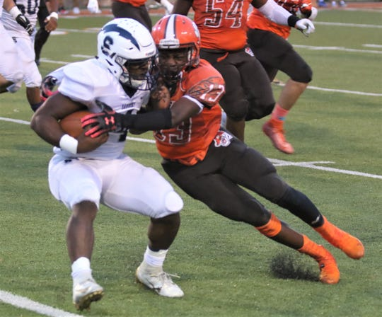 Mansfield Senior's Aveon Grose goes head-to-head with Sandusky's Terion Stewart in the Tygers' 21-14 win over the Blue Streaks on Friday night at Arlin Field.