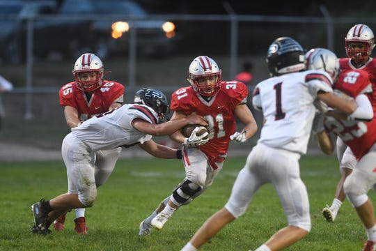 Shelby's Brinson DeLauder tries to slice through the Marion Pleasant defense during the Whippets' 54-33 win in Mid-Ohio Athletic Conference action Friday night.