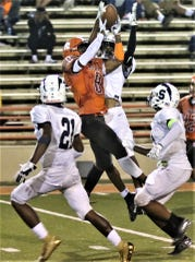 Mansfield Senior's Angelo Grose goes up and over three defenders to haul in a 47-yard pass setting the Tygers up for a fourth quarter score in a 21-14 win over Sandusky on Friday night at Arlin Field.