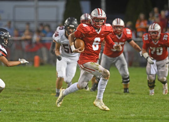 Shelby's McGwire Albert finds running room Friday night as the Whippets hosted Marion Pleasant.