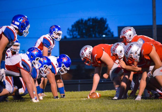 Elgin quarterback Evan Backensto lines up behind center Friday night in a Northwest Central Conference football against Riverside. Backensto threw two touchdowns and completed 9 of 16 passes for 175 yards.