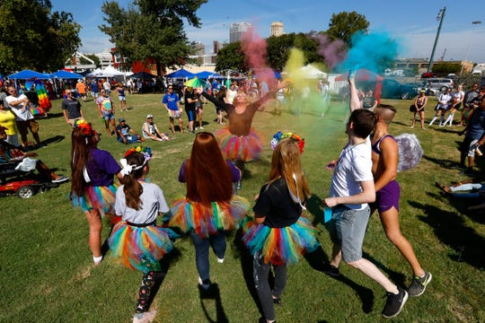 Will Keedy performs as 'Scarlett Rose' with the help of a rainbow themed chalk dusting during a drag show at the Stonewall stage inside Robert R. Church Park, part of the Mid-South Pride festival downtown on Saturday, Sept. 28, 2019.