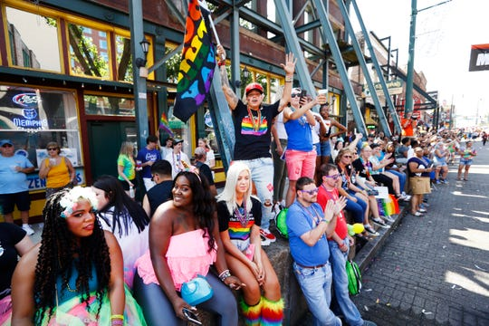 People watch and cheer from the sidewalk along Beale Street during Mid-South Pride festival downtown on Saturday, Sept. 28, 2019.