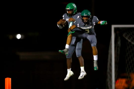 White Station wide receiver Brandon Harris, right, helps celebrate Jaylen Caver's touchdown  during their game against Bartlett at the Fairgrounds Stadium on Friday, September 27, 2019.