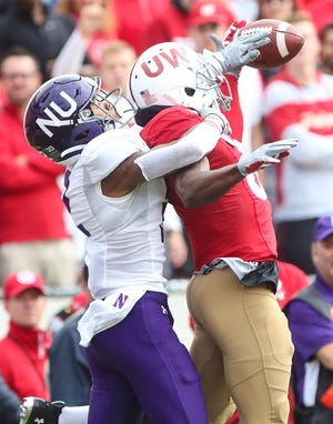 Northwestern's Greg Newsome II breaks up a pass intended for Wisconsin's Guintez Cephus  in the forth quarter.
