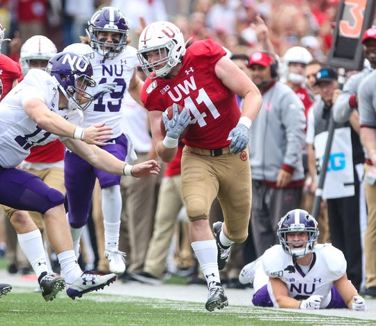 Wisconsin's Noah Burks runs 68 yards for a touchdown after an interception in the fourth quarter against Northwestern.