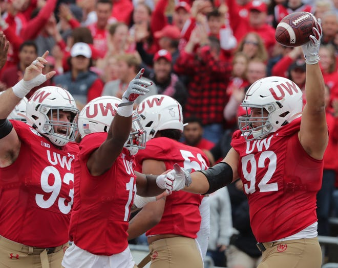 Wisconsin defensive end Matt Henningsen (92) celebrates his fumble recovery for a touchdown during the fourth quarter against Northwestern in 2019.