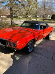 This photo shows the 1969 Pontiac Firebird convertible before it was reported stolen.