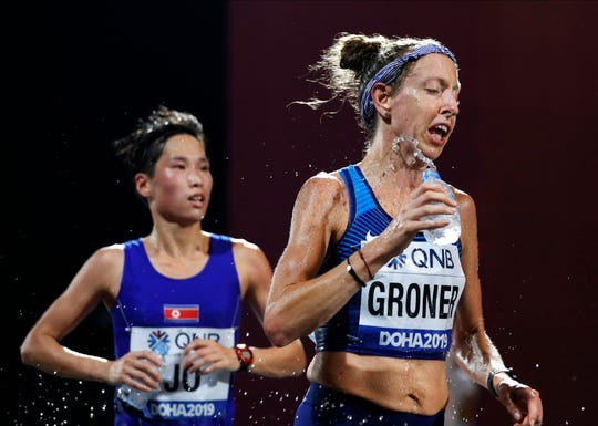 Roberta Groner, a 41-year-old from Ledgewood, pours water on herself during the women's marathon at the World Athletics Championships in Doha, Qatar, Saturday, Sept. 28, 2019. (AP Photo/Petr David Josek)