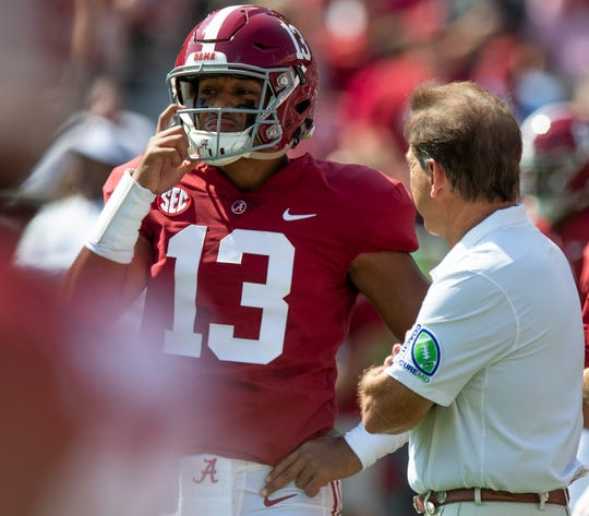 Alabama head coach Nick Saban talks with quarterback Tua Tagovailoa (13) before the Ole Miss game at Bryant-Denny Stadium in Tuscaloosa, Ala., on Saturday September 28, 2019.