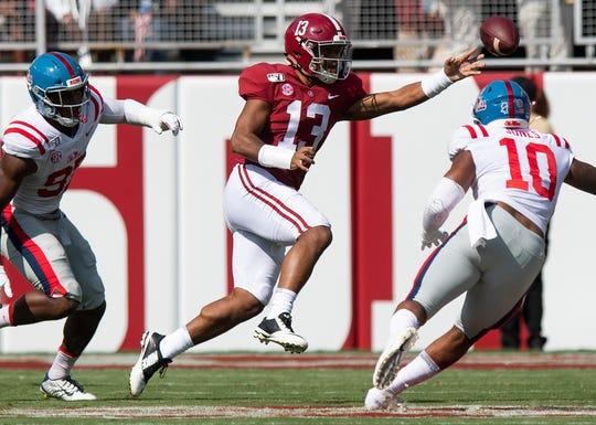 Alabama quarterback Tua Tagovailoa (13) passes under pressure against Ole Miss at Bryant-Denny Stadium in Tuscaloosa, Ala., on Saturday September 28, 2019.