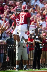 Alabama wide receiver DeVonta Smith (6) and Alabama wide receiver Henry Ruggs, III, (11) celebrate Smith's touchdown against Ole Miss at Bryant-Denny Stadium in Tuscaloosa, Ala., on Saturday September 28, 2019.