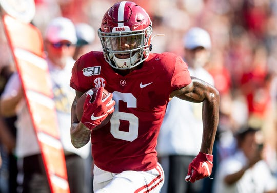 Alabama wide receiver DeVonta Smith (6) scores on a catch against Ole Miss at Bryant-Denny Stadium in Tuscaloosa, Ala., on Saturday September 28, 2019.