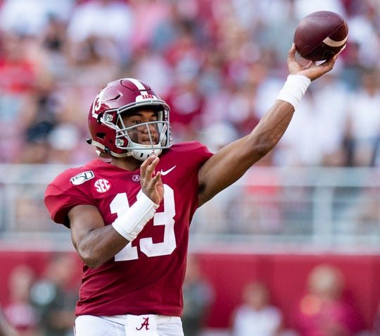 Alabama quarterback Tua Tagovailoa (13) throws a second half touchdown pass to wide receiver DeVonta Smith (6) at Bryant-Denny Stadium in Tuscaloosa, Ala., on Saturday September 28, 2019.