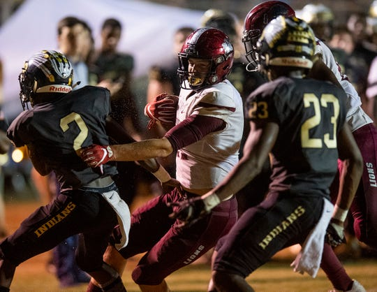 Prattville tight end Taylor Thompson (11) is forced out of bounds by Wetumpka's Devonta Jerido (2) and Avery Thomas (23) at Hohenberg Field in Wetumpka, Ala., on Friday September 27, 2019.