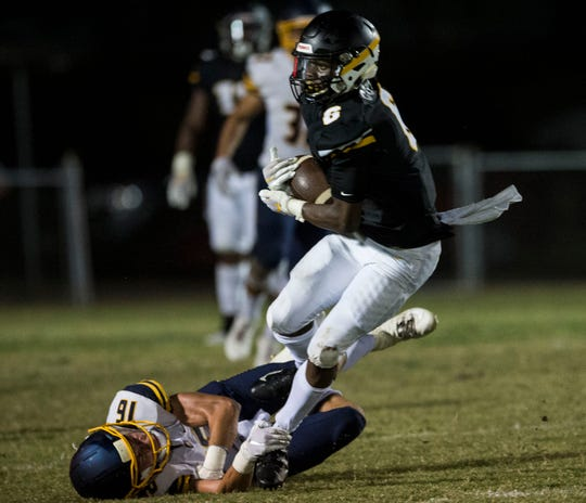 Autauga's  Raymond Cutler (6) is tripped up as he runs the ball at Autauga Academy in Prattville, Ala., on Friday, Sept. 27, 2019. Autauga Academy defeated Tuscaloosa Academy 40-16.