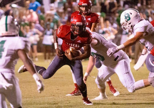 Luverne's Kee-Shaun Glanton runs the ball during the first half against Brantley.