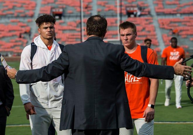 Auburn quarterback Joey Gatewood, left, and quarterback Bo Nix, right, listen to Auburn head coach Gus Malzahn game plan at Jordan-Hare Stadium in Auburn, Ala., on Saturday, Sept. 28, 2019.