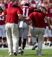Alabama wide receiver Henry Ruggs, III, (11) is helped off of the field after being injured against Ole Miss at Bryant-Denny Stadium in Tuscaloosa, Ala., on Saturday September 28, 2019.